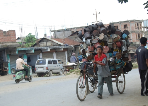 """A rickshaw carrying fire pots (""""meiphus"""") to the market. Since the beginning of December fire pots has been in great demand as Manipur has been reeling under intense cold. 
