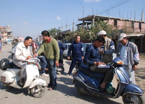 Motorists joining a signature campaign against the Protected Area Permit (PAP) system, which makes it mandatory for a visiting foreigner to obtain a permit before entering Manipur. | 2010-12-20