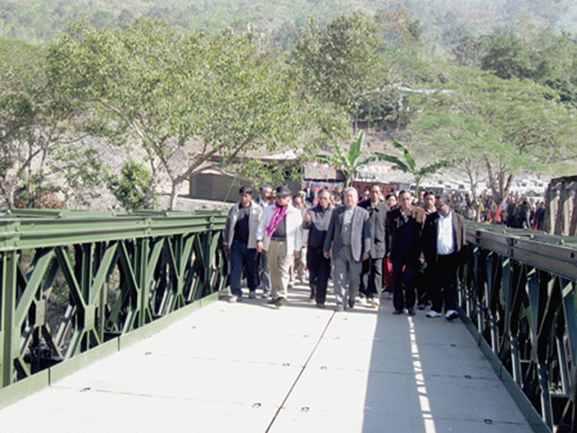Works minister K. Ranjit, G. Gaikhangam, MLA of Nungba A/C, and officials of state PWD inspecting the newly inaugurated Nungleiband Bridge over the Leimatak River under Nungba sub-division in Tamenglong district constructed by Public Works Department, Manipur. 2010-12-25 | by : IFP Photo