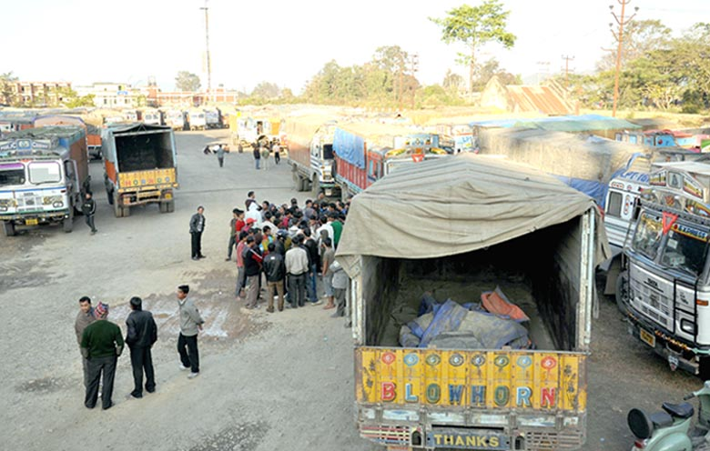 Stranded requisitioned trucks on FCI duties at Khuman Lampak on Monday.