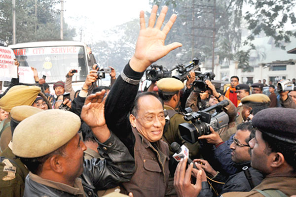 Arrested UNLF chairman RK Meghen waving to the people who had turned up to greet him at the NIA court premises in Guwahati.