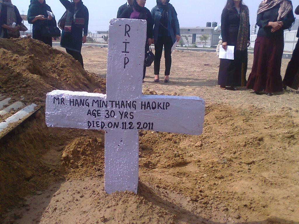 PS. Hangminlen Haokip is misspelled as Hangminthang Haokip in the wooden cross : Courtesy: KUKI STUDENTS' ORGANISATION DELHI