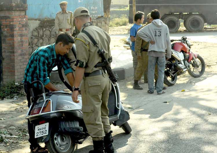 Personnel of Manipur police on frisking duty as a part of security measures prior to the visit of President Pratibha Patel on Wednesday.