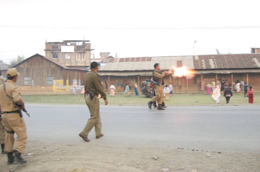 A police personnel firing tear gas shell towards a mob at Khurai today.