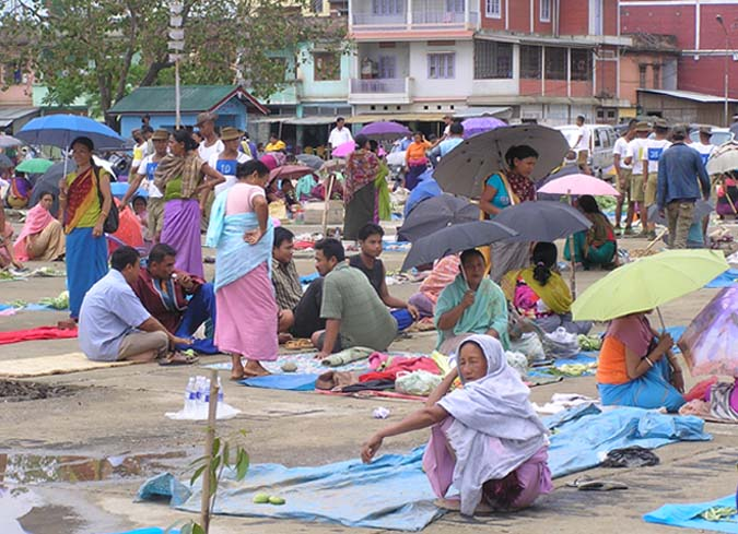 Street vendors and local people trying to outdo each other in snatching any available vending space at the Lamphel Supermarket even though the government has only allotted the site to the street vendors who are shifted from around the Khwairamband Keithel.