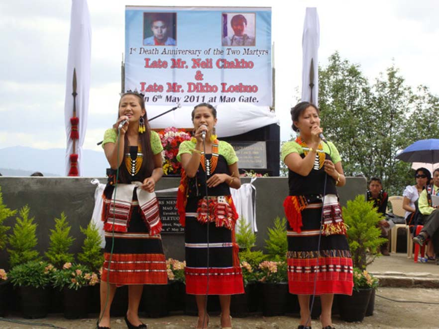 Girls in traditional attire singing during the 1st first anniverssary of the death of two students in Mao on May 6, 2010.