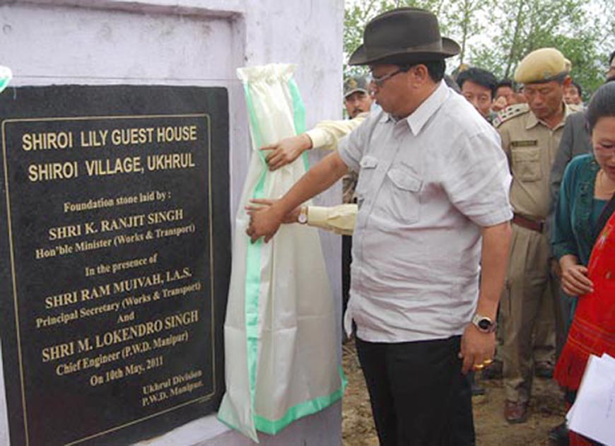 Work minister K. Ranjit unveiling the foundation stone laid for the construction of guest house at Shirui Village.