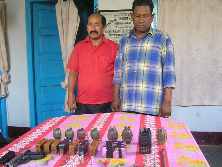 The two RPF/PLA cadres arrested by Imphal West police commandos being paraded before mediapersons along with the recovered arms at the CDO complex.