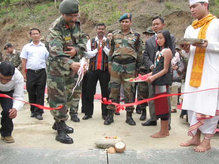 Brig Narendra Kumar, DIG 17 AR cutting the ribbon while inaugurating the suspension bridge at Chalou village.