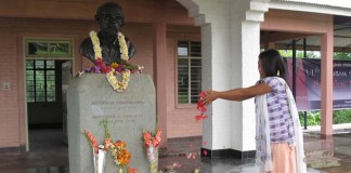 A young girl paying floral to the statue of Arambam Samarendra erected at Khurai Nandeibam Leikai on 11th death anniversary of the Manipuri martyr Friday.