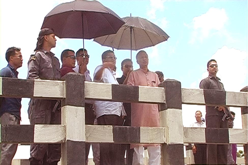 Chief Minister O Ibobi flanked by works minister K Ranjit and others during an inspection tour of the Leishing Hiden today.