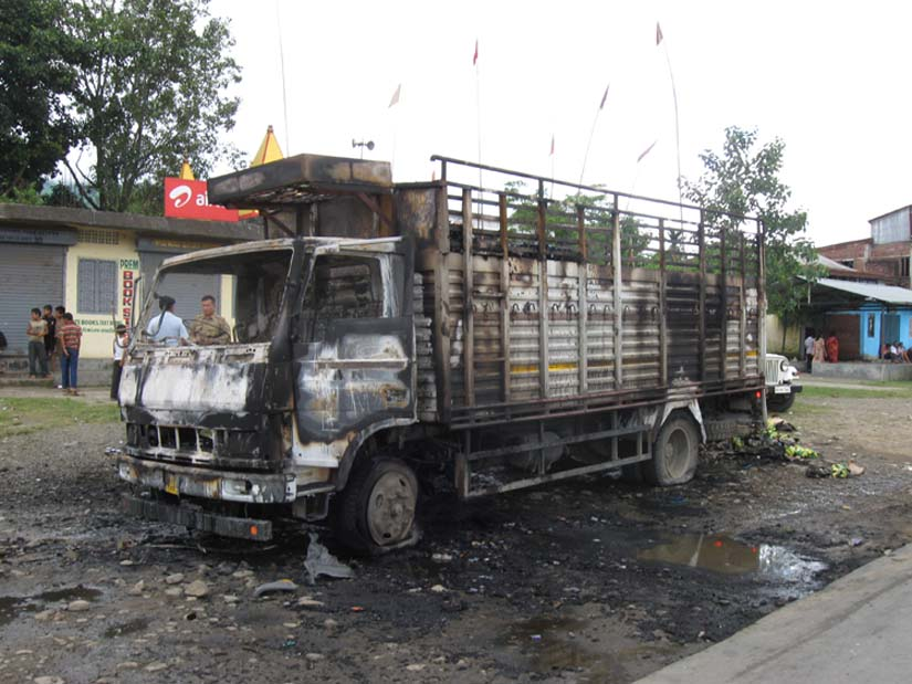 A goods-laden truck burnt by suspected blockade supporters at National Highway-2.