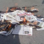 Copies of The Telegraph, Kolkata being burned down by the volunteers of Apunba Lup condemning the news report on Sharmila's purported love relationship with an NRI man on Tuesday.