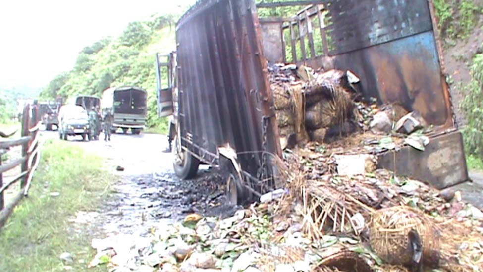 A loaded truck burnt down by the agitated volunteers of Sadar Hills Districthood Demand Committee at Kangpokpi on the evening of September 6.