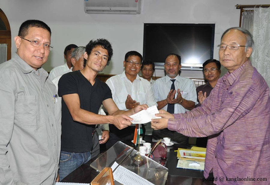 State Chief Minister O Ibobi Singh today felicitated Olympian Kadangbam Kothajit and handed over a sum of Rs 2 lakh on Monday.