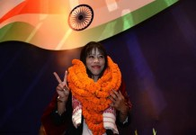London Olympics bronze medallist Mangte Chungneijang Mary Kom smiles during a felicitation function in New Delhi on August 14, 2012