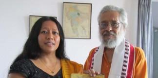 Ms Binalakshmi Nepram presenting the book Cheitharol Kumbaba The Royal Chronicle of Manipur by Nepram Bihari to Prof Basudev Chatterji Chairman of ICHR