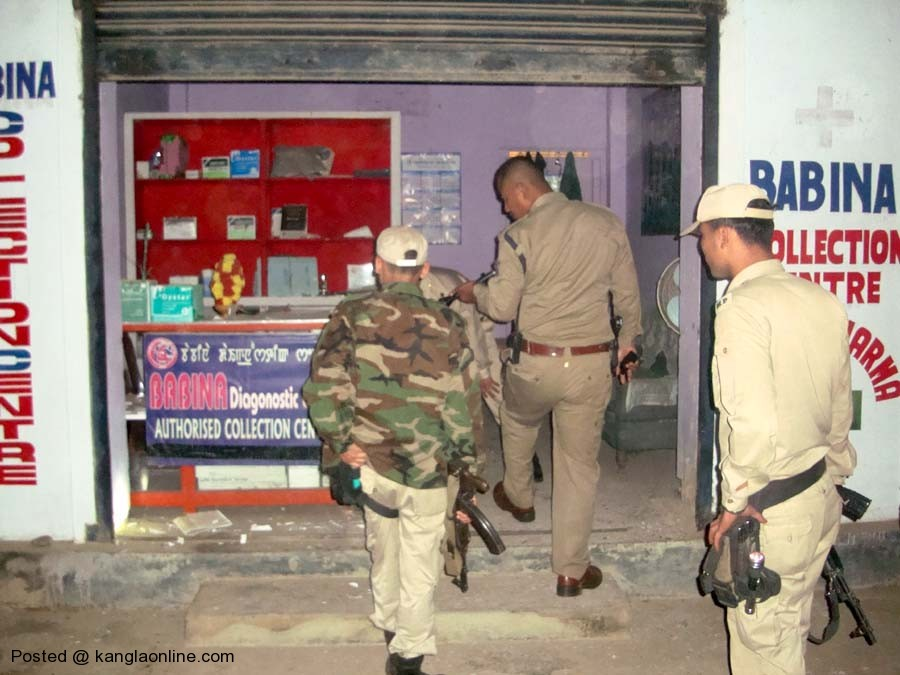 Imphal East Police inspecting the bomb explosion site at Porompat on Friday.