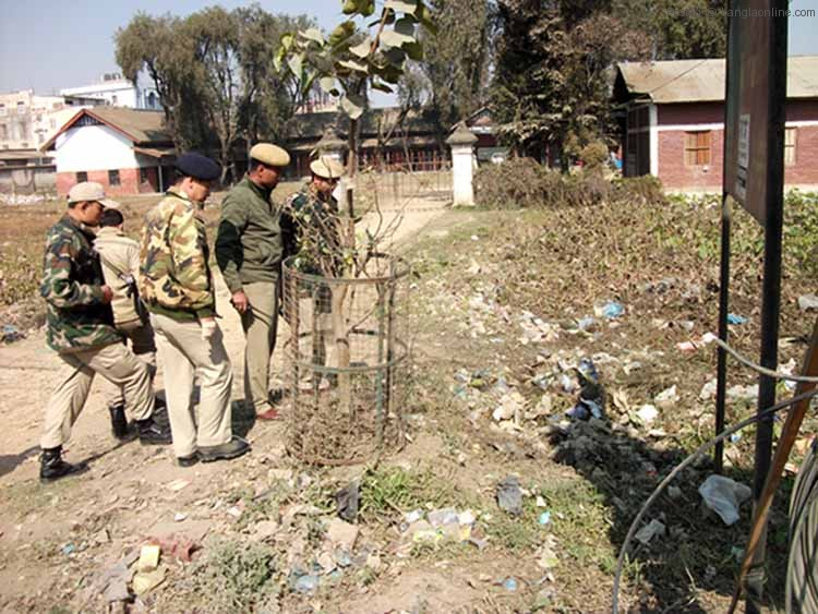 Imphal East police inspecting the explosion site in front of the Raja Dumbra High School on Friday