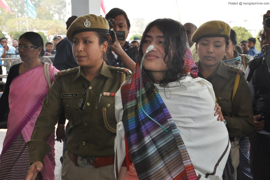 Irom Chanu Sharmila being led into the Imphal Tulihal Airport by policewomen on Sunday.