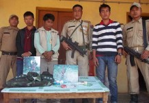 Manipur Drug Haul - Thoubal police parading the arrested NSCN (IM) captain with the seized drugs on Sunday.