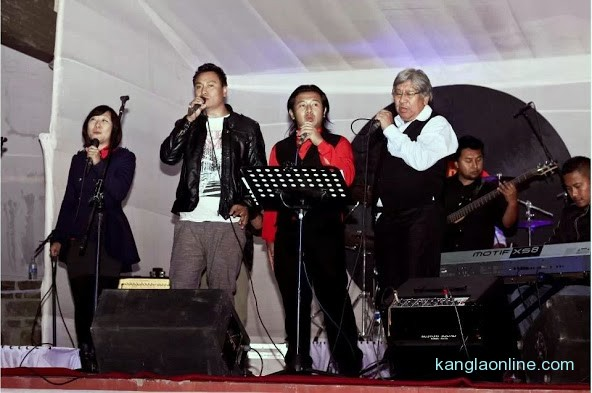 Chief Guest of The Beatles Mania Show, Dr Nicky Kire (right), Parliamentary Secretary, Law and Justice, Land Revenue, Labor and Employment, singing together with the 3 bands on the stage amidst cheers from the capacity crowd on Saturday night at The Heritage, Kohima.