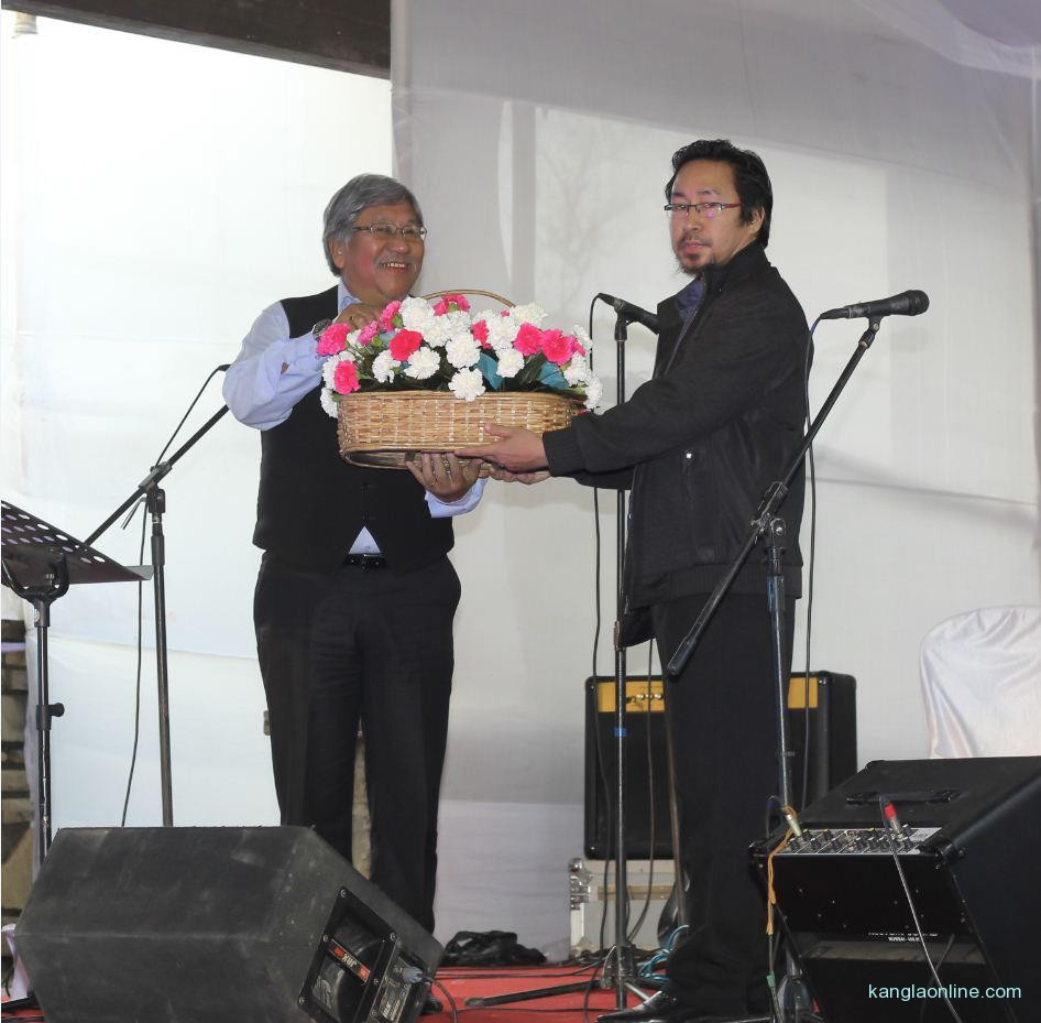 "Oken Jeet Sandham (right) presenting ""Bouquet"" to Chief Guest of The Beatles Mania Show, Dr Nicky Kire (left), Parliamentary Secretary, Law and Justice, Land Revenue, Labor and Employment at The Heritage, Kohima on April 27, 2013."
