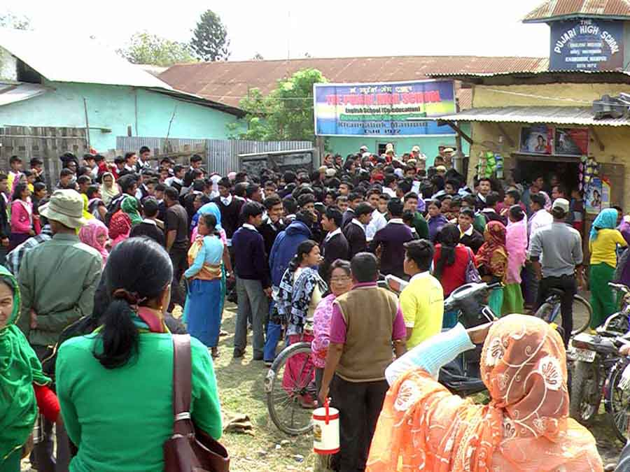 8 Students as police resorted to firing tear gas shells and mock bombs at a mob of students and their guardians at Pujari High School, Khangabok