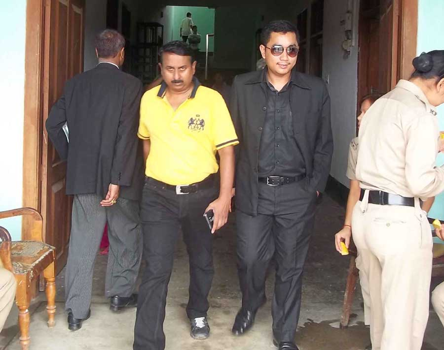 Accused PRO Col Ajay Chowdhury coming out of the court room with another accused. Photo: IFP