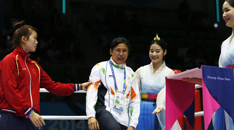 Laishram Sarita refusing to accept Asian Bronze Medal in protest against dubious judging.
