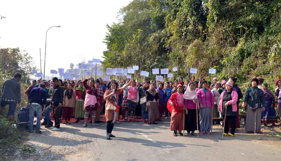 Women folk raising placards while imposing bandh at Tengnoupal along the Imphal-Moreh highway.