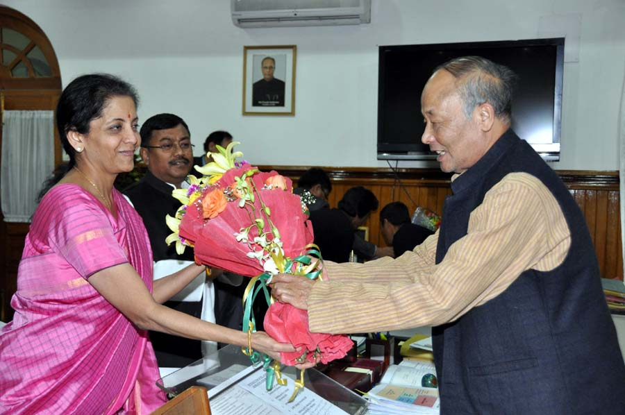 Chief Minister Okram Ibobi Singh handing over a bouquet to Union Ministr of Commerce and Industries Nirmala Sitharaman on Monday.