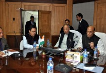 Union Home Minister Rajnath Singh,Chief Minister Okram Ibobi and Union Minister of State for Home, Kiran Rijiji at a meeting.