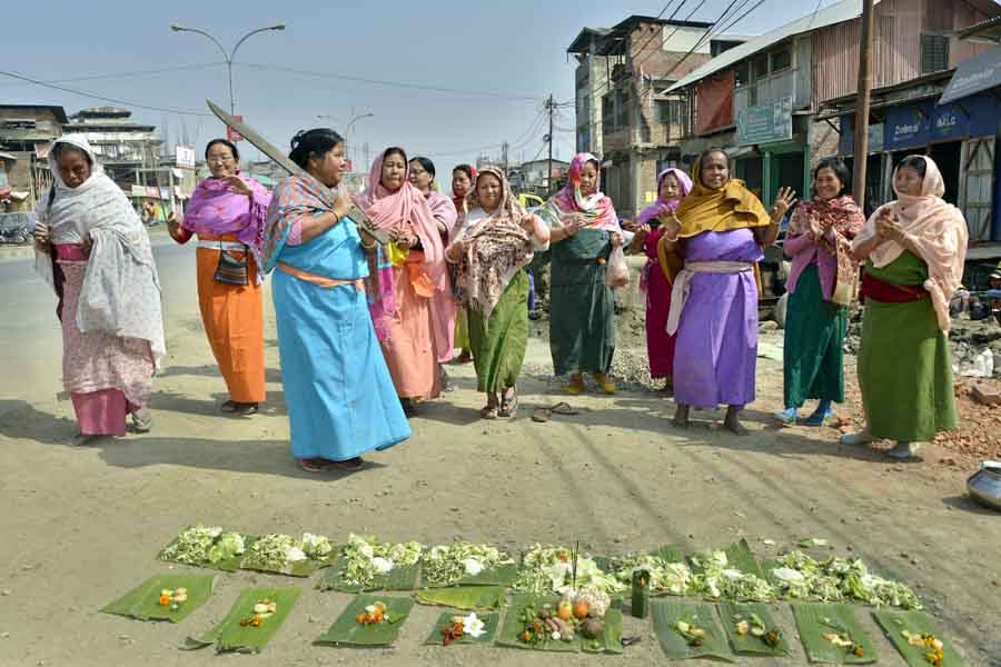 Meitei womenfolks observing traditional Saroi Kangba rituals on the auspicious Saturday of lunar month Lamta