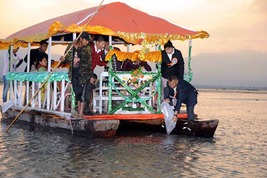 CEO of Chanura Microfin releasing hatchlings of fishes at Loktak Lake in observation of 8th Foundation Day of Chanura Microfin.