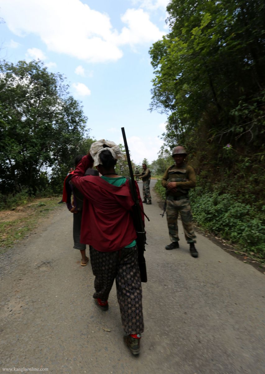 Villagers roaming around with air gun at the ambush site at Paraolon, Chandel District, Manipur. Photo by Deepak Shijagurumayum.