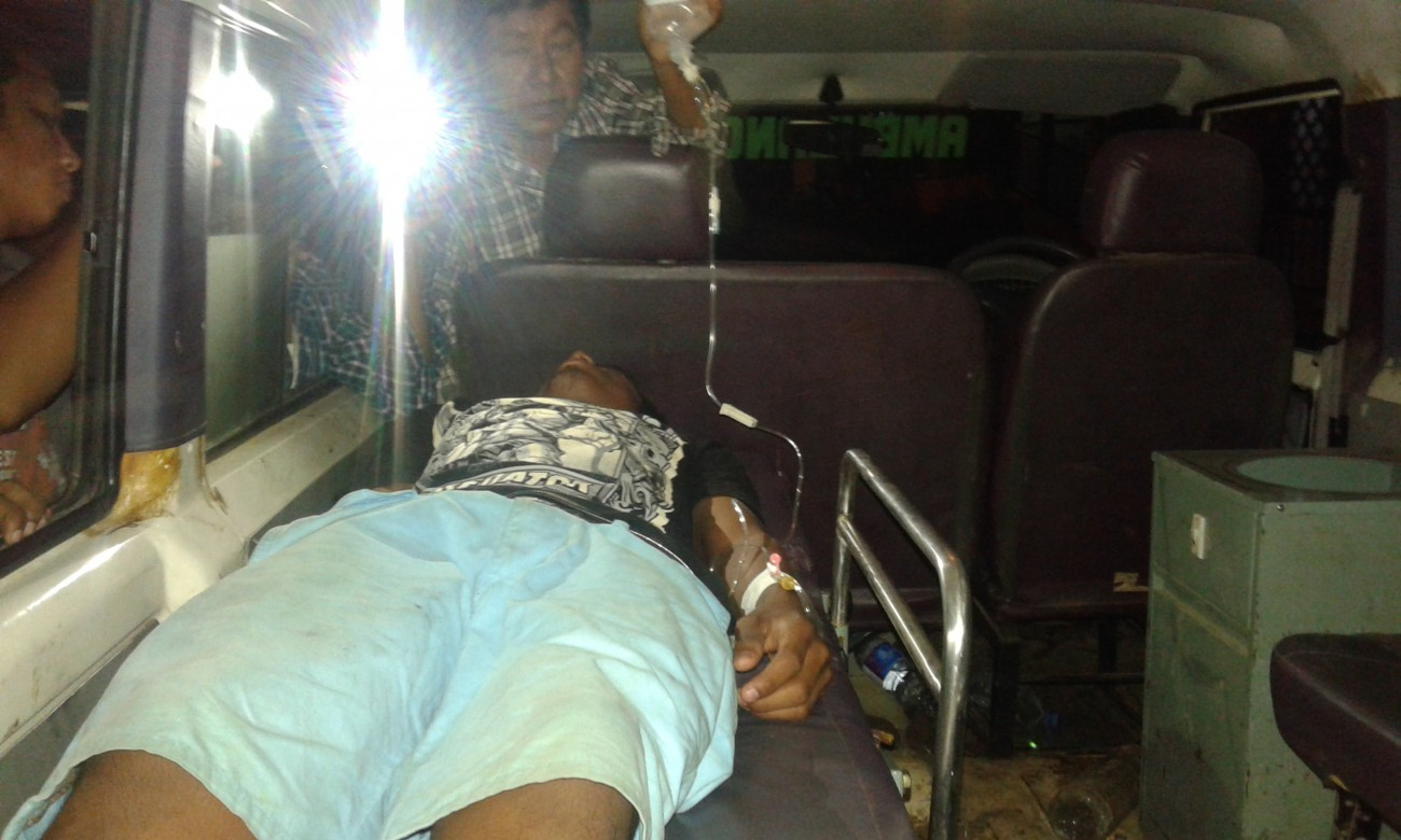 An injured protester in ambulance.