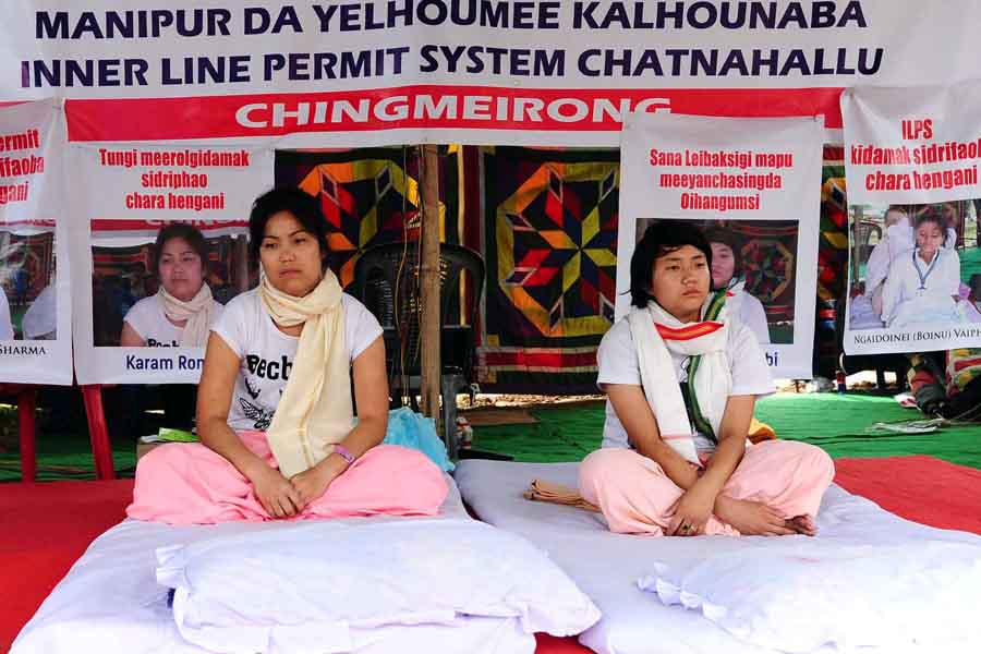 A young girl joins a woman on hunger strike at Chingmeirong