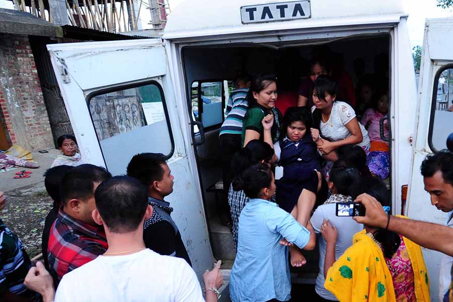 A girl student being picked up from her hunger strike venue by the concern authorities.