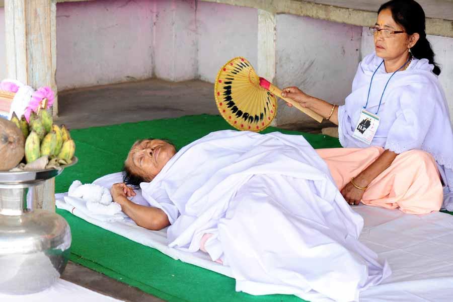 A woman attends to octogenarian hunger striker Aribam (o) Shamurailatpam (n) Sanahanbi Devi on Friday.
