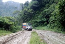 A truck trying to manoeuvre through the muddy Imp-Jiribam Highway stretch at Makru.