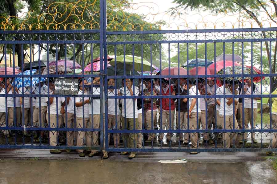 Women IRB personnel closing the gate of Khuman Lampak Sports Complex