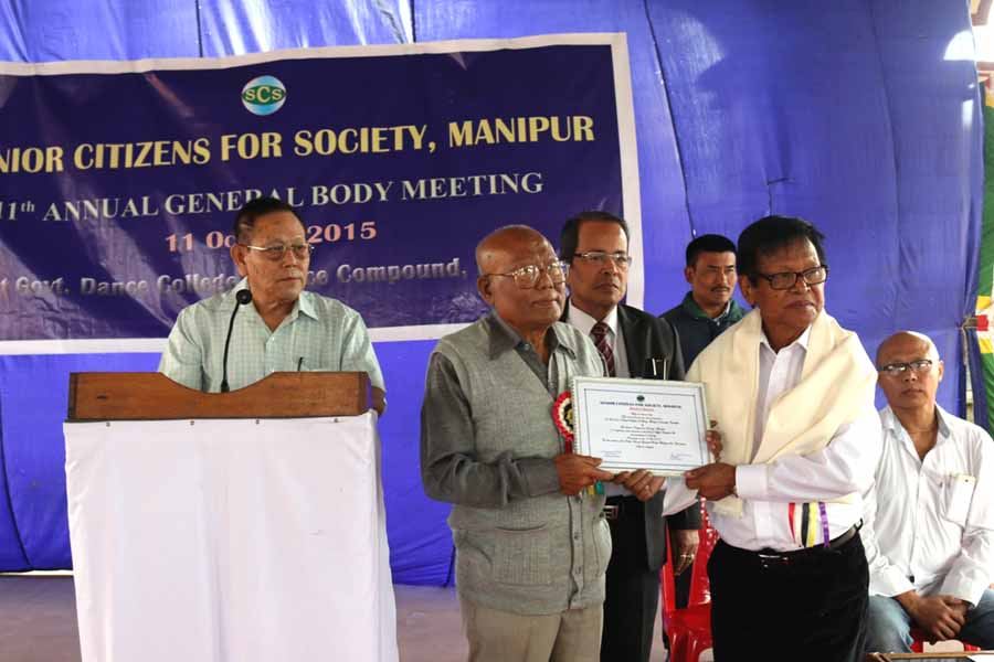 Prof Laldena receives the scroll of honour presented by Senior Citizens for Society, Manipur at Government Dance College, Palace Compound.