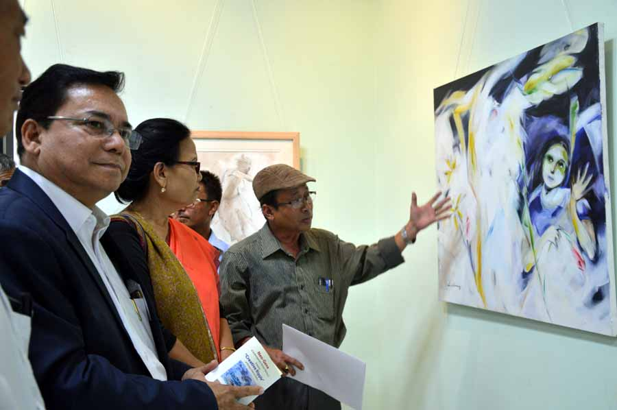 Art and Culture director Dr K Sushila take a look at one of the paintings.