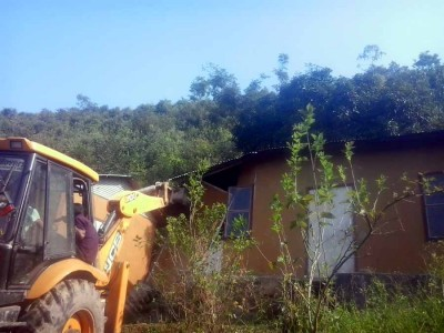 A bull dozer being used to tear down an encroachment inside the Heingang Reserved Forest area on Saturday.