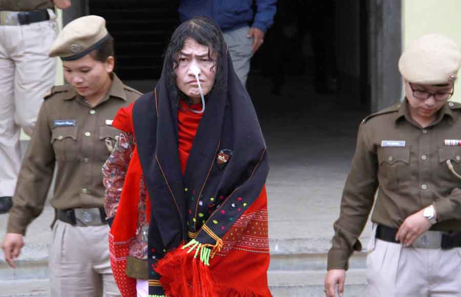 Police women escorting Sharmila from the court room.