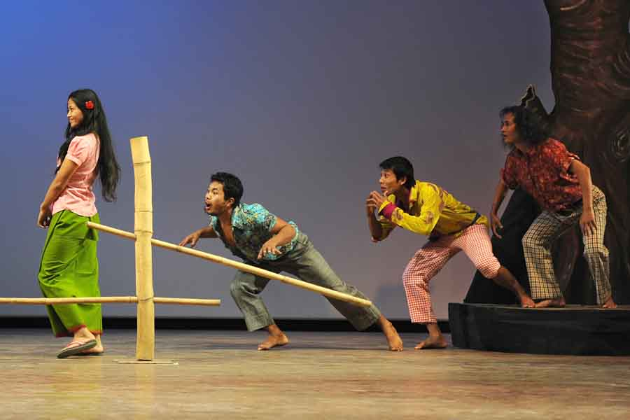 A scene from the play Tamnalai being played by artists of Kalakshetra Manipur at Maharaj Chandrakirti Auditorium. IFP Photo