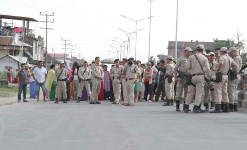 Police personnel trying to pacify the agitating locals of Singjamei and to call off the road block on Tuesday. IFP Photo