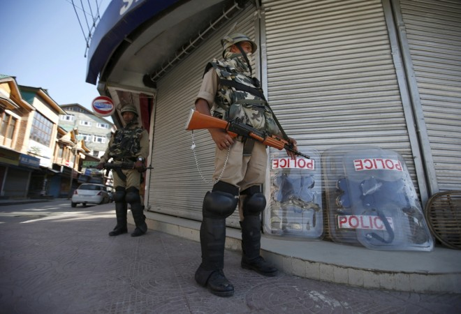 Manipur: Bomb blast in BSF camp injures 7-year-old Pictured: Indian Central Reserve Police Force (CRPF) personnel stand guard in front of closed shops.[REPRESENTATIONAL IMAGE]Reuters