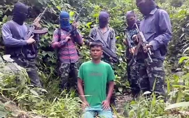 Kuldeep Moran surrounded by five armed insurgents.